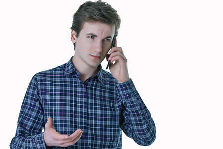 Closeup portrait of young, serious business man, corporate employee, student talking on cell phone. 스톡 콘텐츠