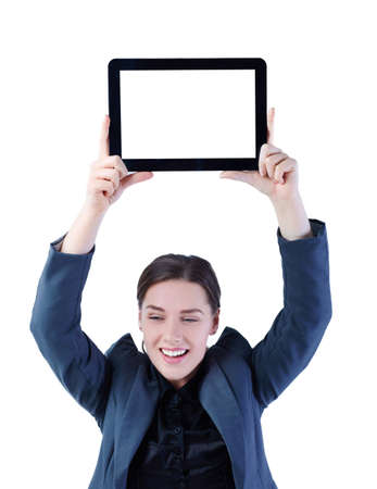 Happy businesswoman holding over the head digital tablet with blank screen. Isolated on white.