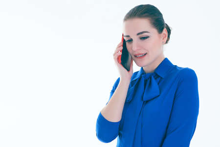 Sad real estate female agent talking on mobile phone. Isolated on white. 스톡 콘텐츠
