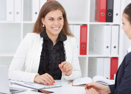 Young confident business expert with female colleague. Business and partnership, job offer concept.