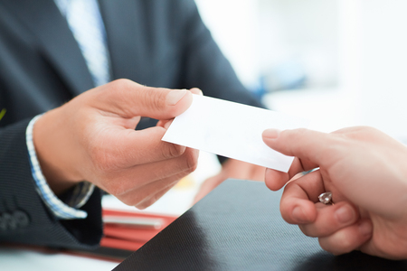 Business people change business cards on meeting seminar or conference. Stock Photo
