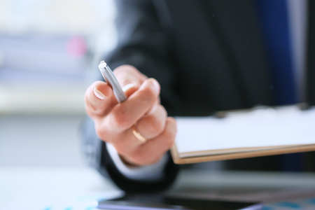 Businessman's hand gives pen offers to sign new job employment contract, partner promising good deal convincing to agree on terms of loan insurance put signature on legal business document.
