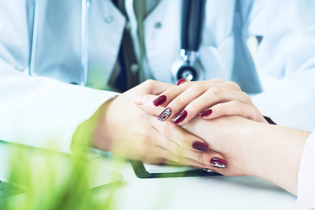 Cropped image of female therapist holding patients hands during the consultation. Medical ethics and trust concept 写真素材 - 120746108