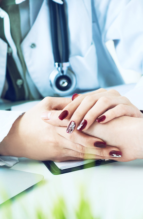 Cropped image of female therapist holding patients hands during the consultation. Medical ethics and trust concept 写真素材 - 121284082
