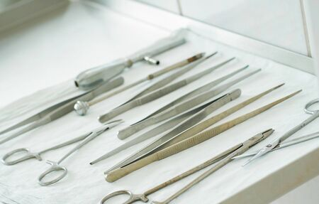 Medical instruments for surgery are on metal table in the operating room close-up.
