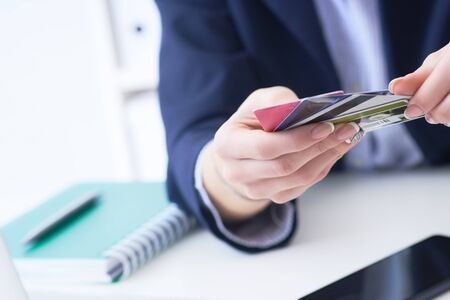 Woman with many different credit cards. Anti-fraud and financial security, entering client discount program number, filling personal information concept.