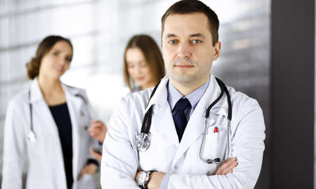 Professional middle aged doctor with a stethoscope and crossed arms at work in a clinic. Perfect medical service in a hospital. Medicine and healthcare concept