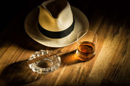 Rum, cigar and a hat Stockfoto