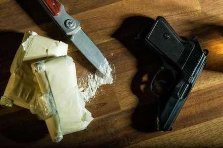 dependance: cocaine and a gun