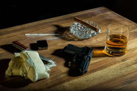 cocaine, cigar, alcohol and a gun