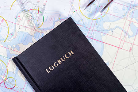 navigation book with sea charts in the chart room on a sailing yacht Reklamní fotografie - 92154378