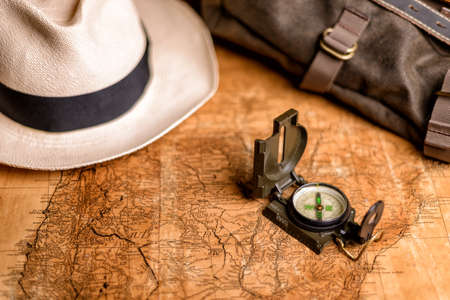 Old expedition map with compass and binoculars