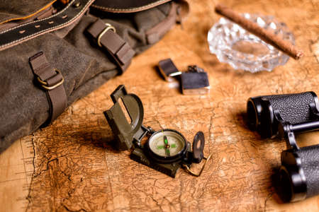 old expedition map with compass and binoculars Reklamní fotografie