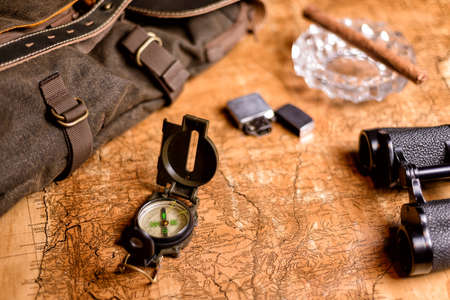 old expedition map with compass and binoculars Reklamní fotografie - 93767331