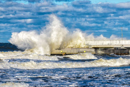 Big braking waves during a gale at Kolobrzeg on the coast of the Baltic sea in Poland Stock Photo