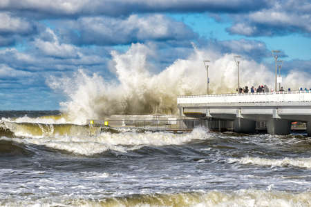 big braking waves during a gale in Kolobrzeg on the coast of the Baltic sea in Poland Stock Photo