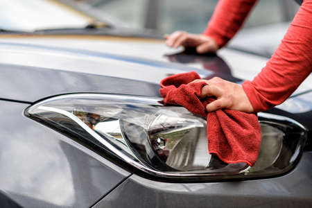 polishing a car with a rag after the car wash
