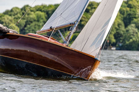 classic sailing yacht sailing on a lake during a regatta Standard-Bild - 108241219