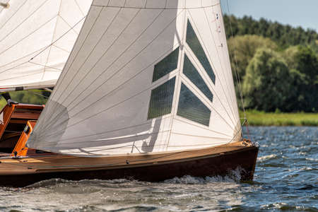 classic sailing yacht sailing on a lake during a regatta