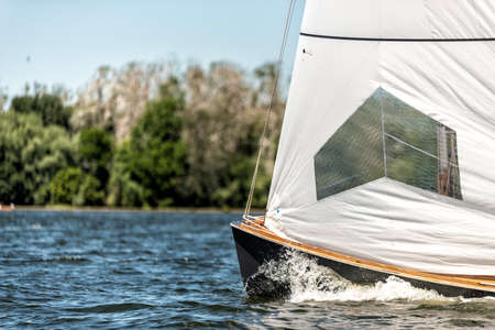 classic sailing yacht sailing on a lake during a regatta