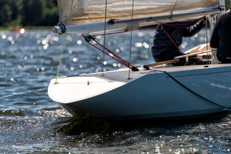 stern of a classic sailing yacht sailing on a lake during a regatta