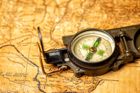 old expedition map with oldfashioned magnetic compass