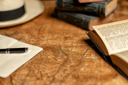 old expedition map with notebook, other books and panama hat Reklamní fotografie