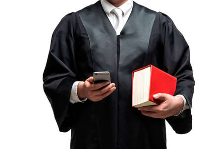 german lawyer with a classical black robe, white tie and book Stock Photo
