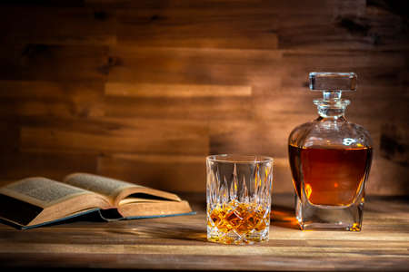 glass of rum and old book in a bar in Cuba Stock Photo