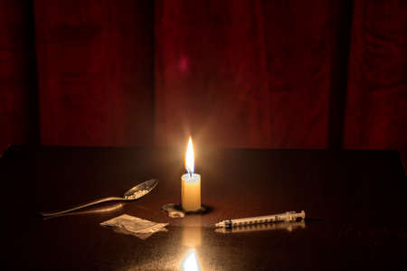 injection, candle and Heroine of a junkie