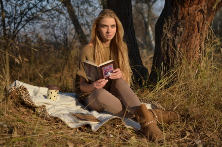 cull: young woman at the autumn meadow autumn blonde in November