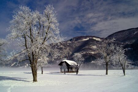 outbuilding: Winter landscape with old barn.