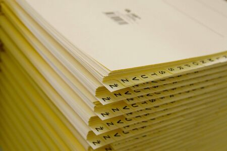 alphabetical order: Stack of papers in alphabetical order. Stock Photo