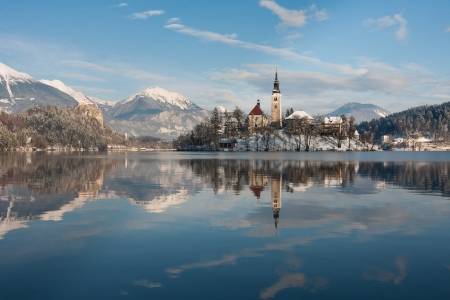 View on lake Bled with small island with church and castle on rock in Slovenia, Europe.