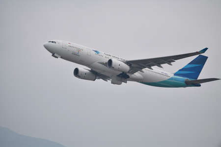Hong Kong, China - March 25th 2018 : Garuda Indonesia aircraft inflight from Chek Lap Kok airport in Hong Kong. Editorial
