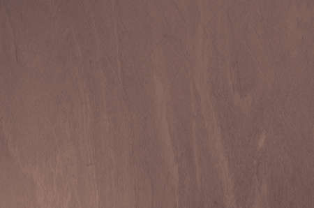 pinkish: Flat, smooth wooden background in pinkish color.