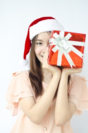 Smiley Asian woman in santa hat hold a box gift on her hand  photo