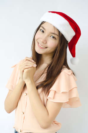 Young beauty Asian girl with santa hat   photo