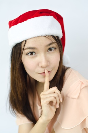 Cute surprised Santa girl smile covering her mouth with her finger photo