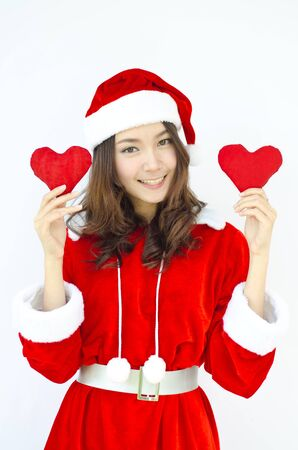 A Beautiful Asian santa woman in red cloth with red heart in her hand photo