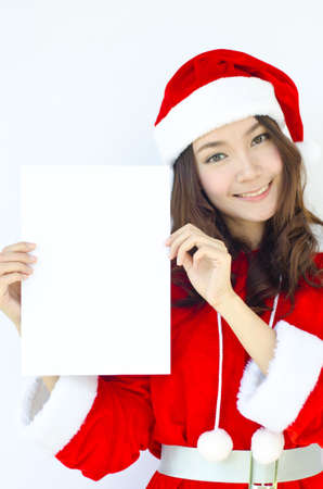 A Beautiful Asian santa woman in red cloth with copyspace  photo