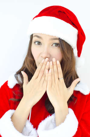 Cute surprised Santa girl smile covering her mouth with her fingers  photo