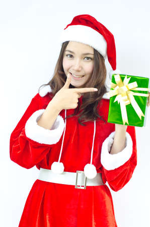 A Smiley Asian santa woman hold a green box gifts on her hand  photo