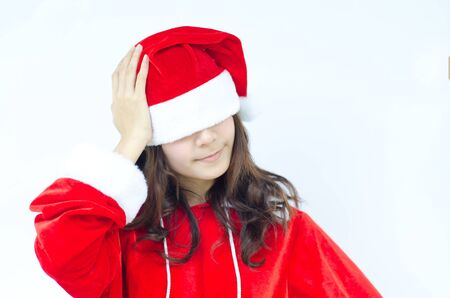 Beautiful young santa clause woman in christmas clothes smiling  photo