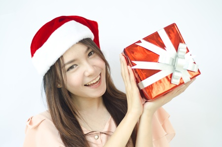 Santa woman showing gift wearing Santa hat  photo