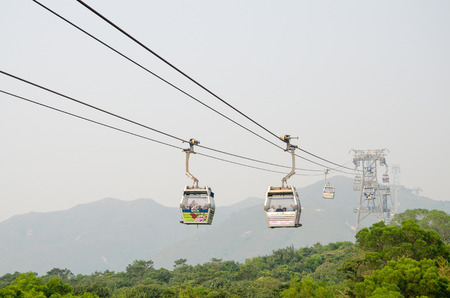 operated: HONG KONG - OCTOBER 21: Ngong Ping Cable Car October 21, 2013 in Hong Kong, PRC. The 5.7 km gondola which connects Tung Chung and Gnong Ping on Lantau Island is operated by Mass Transit Railway (MTR).