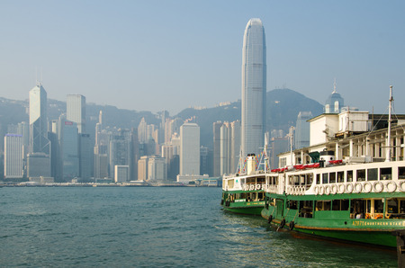 HONG KONG - OCTOBER 22: Ferry leaving Kowloon pier on October 22, 2013 in Hong Kong. Hong Kong ferry is in operation in Victoria harbor for more than 120 years and it is one main tourist attractions.
