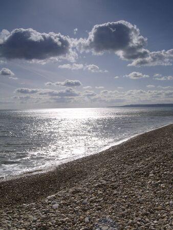 shingle beach: Shimmery Sea and Shingle Beach Stock Photo