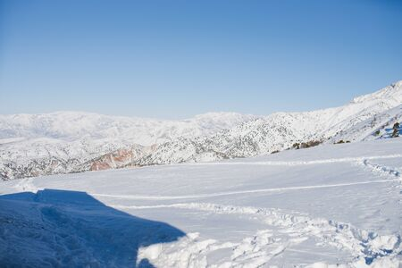 Tien Shan mountains covered with snow in Uzbekistan on a clear day. Beldersay ski resort