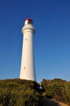 split road: The Split Point Lighthouse on the Great Ocean Road, Australia Stock Photo